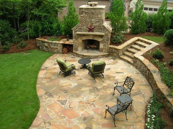 Small outdoor kitchen with flagstone walls and patio