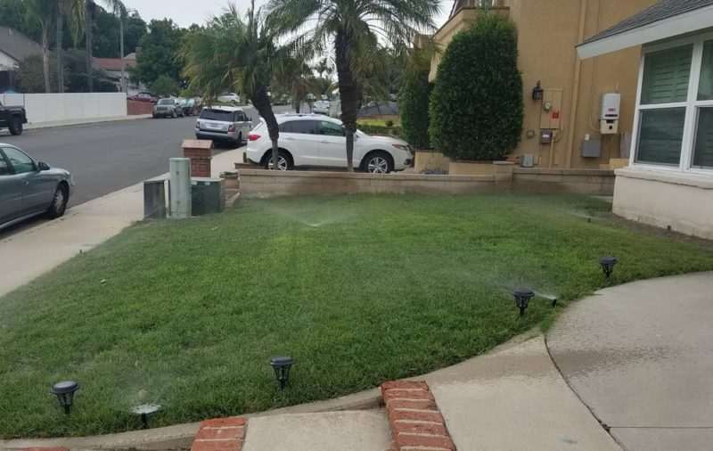 inground sprinklers on residential front lawn